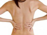 Почему при месячных болит живот и поясница